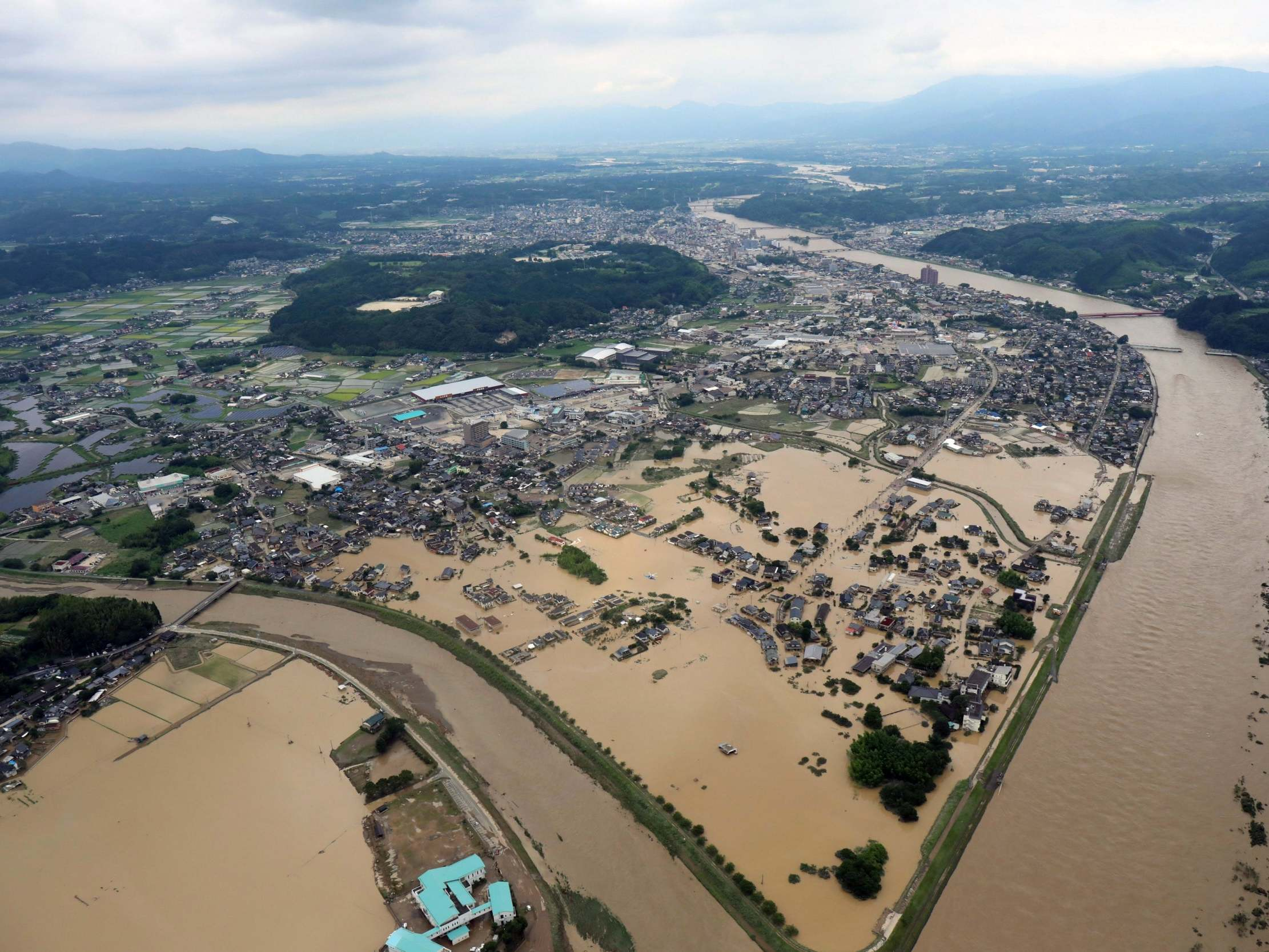 japan floods unprecedented rainfall leaves at least 15 dead and houses swept away amid devastating landslides 7 - China's coal binge could 'undo' global capacity to meet climate targets: Kerry