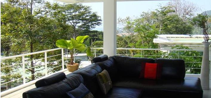 Spacious sea view Condo in Kamala for sale. Offering Apartments for sale and re-sale in a secure community on Phuket for expats, retirees and families. - 1