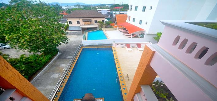 Spacious Top floor Condo near Surin beach for sale. Offering Apartments for sale and re-sale in a secure community on Phuket for expats, retirees and families. - 1